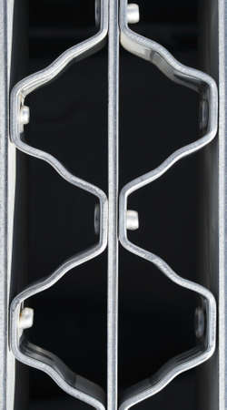 metal grate: Wavy pattern of a metal grate with bolts. Stock Photo
