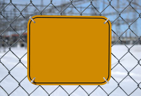 Blank high voltage danger sign with copy space at the chain link fence of a power station. photo