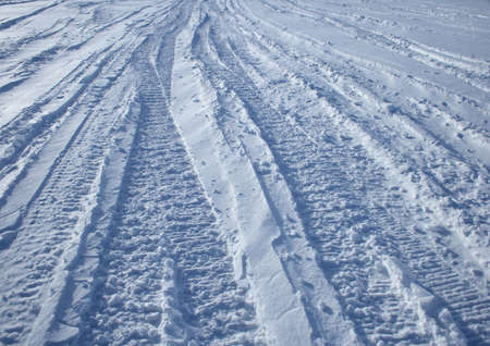 Winter road: vehicle tracks crossing the winter terrain. Stock Photo - 829904