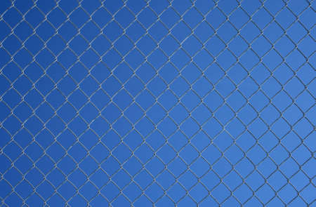 Gray chain link fence on a blue sky background. Stock Photo - 845996
