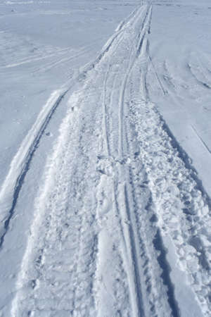 Skidoo track crossing the snowy winter terrain. Stock Photo - 845989