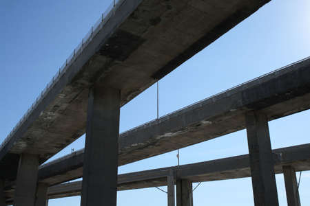 viaducts: Side view of urban highway viaducts against the blue sky.