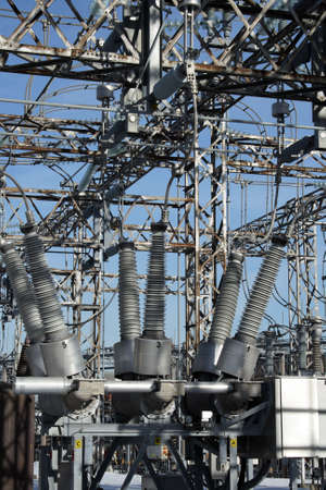 insulators: Insulators and metallic constructions of a high voltage electricity plant.