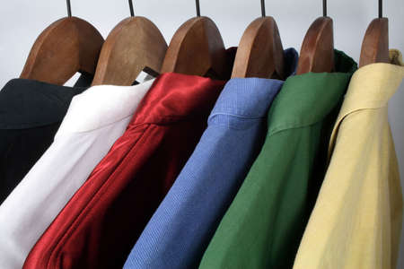 hangers: Mans clothing: choice of stylish colorful shirts on wooden hangers.