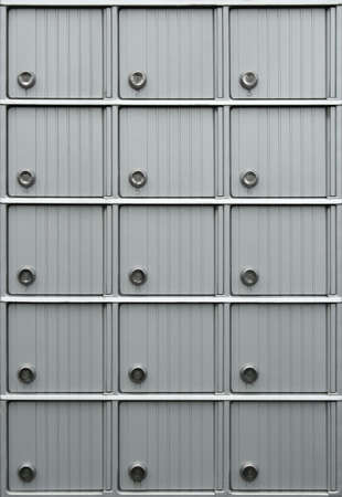 Rows of metallic mailboxes with numbers. Stock Photo - 924958