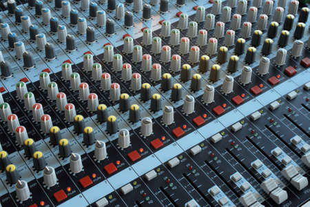 Professional mixing console for audio recording. Music studio.
