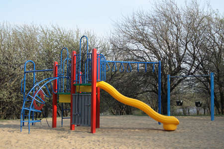 Colorful childrens playground on a spring sunny day. photo