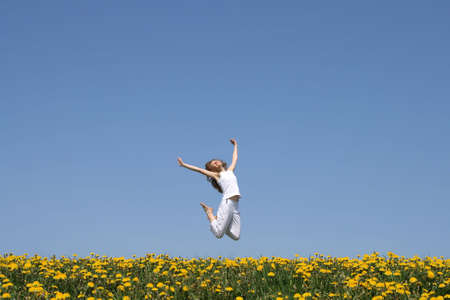 Beautiful smiling young woman in a happy jump. Stock Photo - 963888