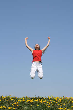 I am the winner! Smiling young woman in a happy jump. Stock Photo - 963891