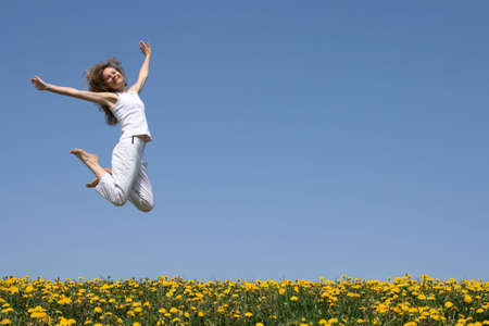 flowering field: Smiling pretty woman in a beautiful jump. Stock Photo