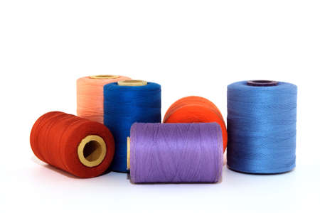Colorful thread bobbins, isolated on white background. Stock Photo