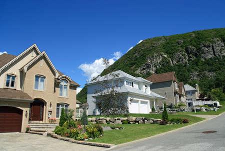 suburban: New houses in a rich suburban neighborhood near the mountain.