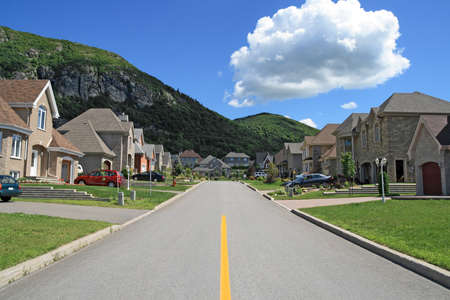 Street leading to the mountain in a rich suburban neighborhood. photo