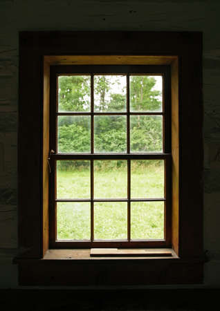 window view: Sunlight coming into the window of an old house. Stock Photo
