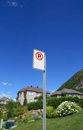 prestigious: No parking sign in a prestigious suburban neighborhood near mountains.