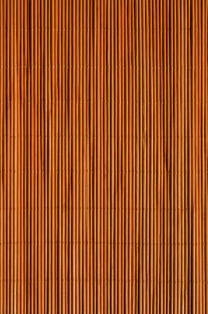 oriental rug: Oriental rattan mat texture of warm orange color.
