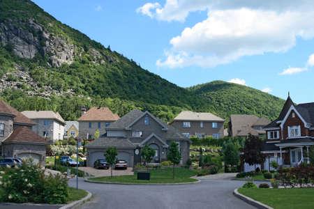 Expensive houses in a prestigious suburban neighborhood near the beautiful mountains. Stock Photo - 1543886