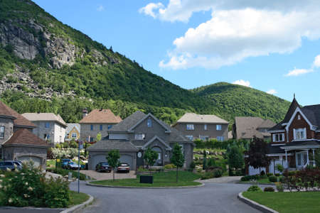 affluent: Expensive houses in a prestigious suburban neighborhood near the beautiful mountains.