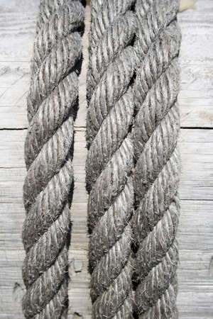 Gray boat rope on wooden background. photo