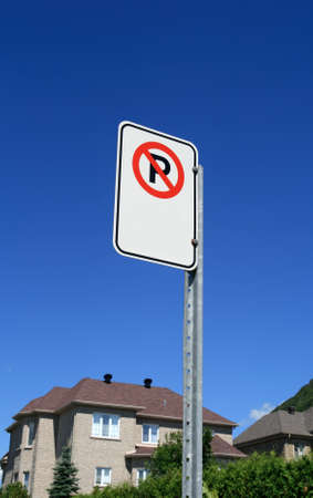 No parking sign in front of a new expensive house in a suburban neighborhood. Stock Photo - 1543873