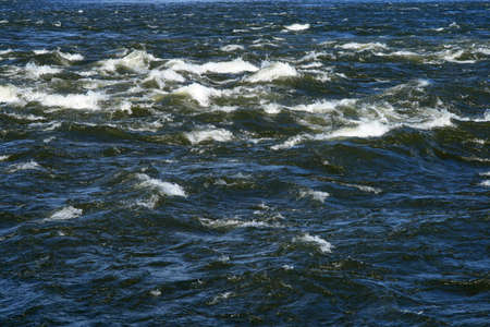 Waves splashing in a river. Water surface texture.