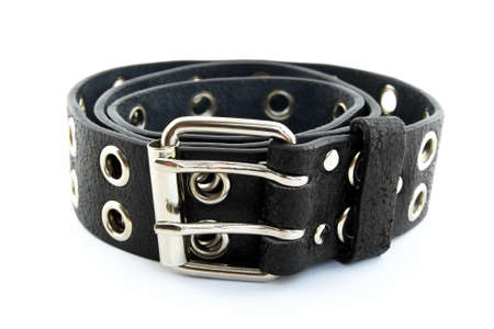 buckle: Black studded leather belt with metal buckle, on white background, shallow DOF. Stock Photo