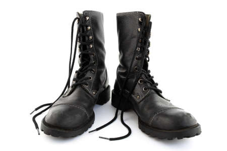 shoelaces: Army style black leather boots with long laces.