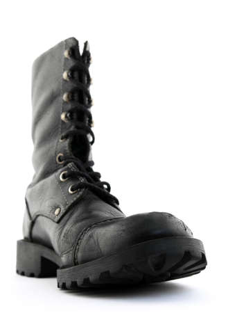 shoestring: Army style black leather boot. Focus on the front part of the boot.
