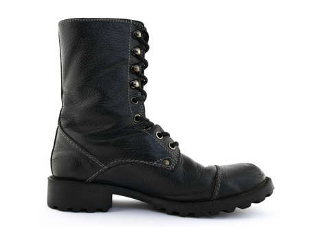 shoestring: Military style black leather boot on white background. Stock Photo