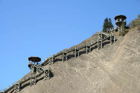 viewpoints: Sightseeing on a steep mountain slope. Wooden stairs and viewpoints.