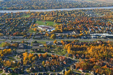 Aerial view of a suburban neighborhood in bright colors of autumn. photo