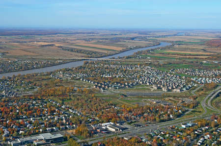 residential area: Aerial view of residential area and river in bright colors of autumn. Stock Photo