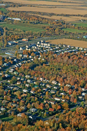 Aerial view of houses and fields in bright colors of autumn. Stock Photo - 1935242