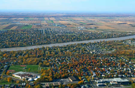 Aerial view of a town near river in bright colors of autumn. Stock Photo - 1953959