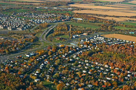 View of a town and highway intersection in bright colors of autumn. Stock Photo - 1953963