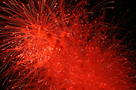 Abstract red fireworks explosion in the night sky. photo