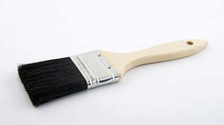 New paint brush with wooden handle.