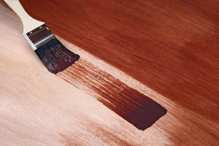Paintbrush and fresh paint on wooden surface. Stok Fotoğraf