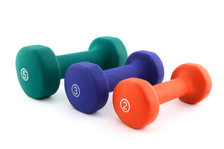 Three colorful dumbbells of different size of white background. Stock Photo