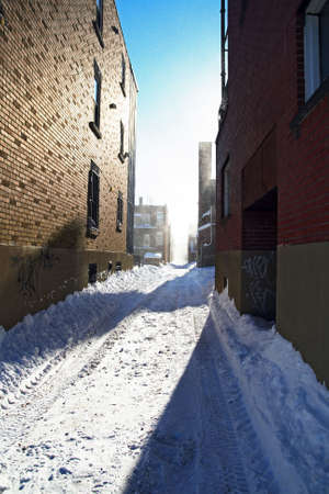 Sunny day after the snowstorm. Urban street covered by snow.