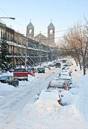 Urban street after the snowstorm. Winter in Montreal. photo