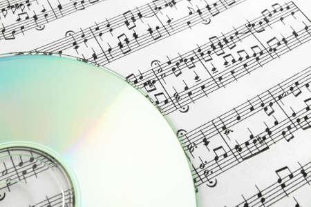 CD on sheet music. Digital music concept. Banco de Imagens