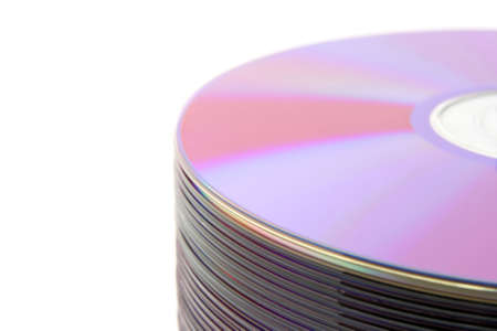 Close-up of stacked purple DVDs or CDs on white background. photo