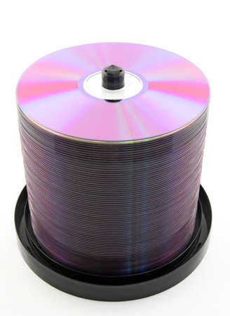 Colorful purple DVDs or CDs on spindle, on white background. No dust. photo