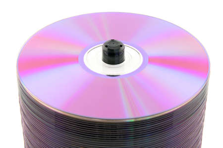 Close-up of purple DVDs or CDs on spindle, on white background. No dust. photo