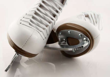 shoelaces: Blades of white figure skates.