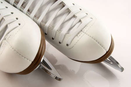 Closeup of elegant white figure skates. Stock Photo