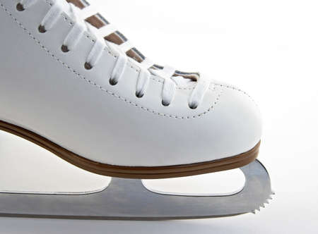 figure skates: Toe and blade of a white elegant figure skate. Stock Photo