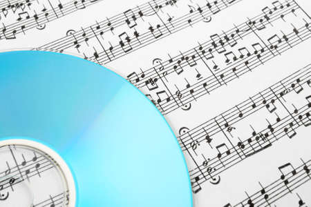 Blue CD or DVD and music notes. Digital music concept. Banco de Imagens