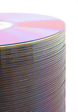 Purple CDs or DVDs on spindle, on white background, shallow DOF. photo